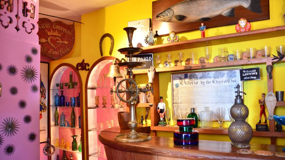 The bar in La Sebastiana is filled with antique glassware from around the world. Neruda kept his favourite whiskeys in a chest. He also collected bottles of wine.  (Dave Seminara)