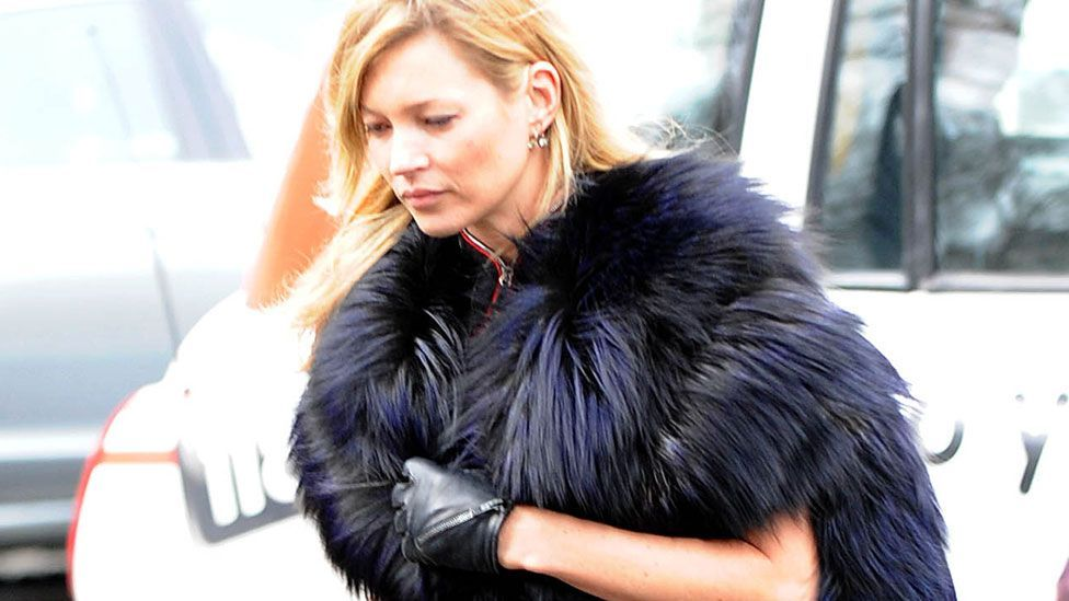 At the 2010 funeral of Alexander McQueen, Kate Moss wore a fur stole and five-inch stilettos (Jeremy Selwyn/Evening Standard/REX)