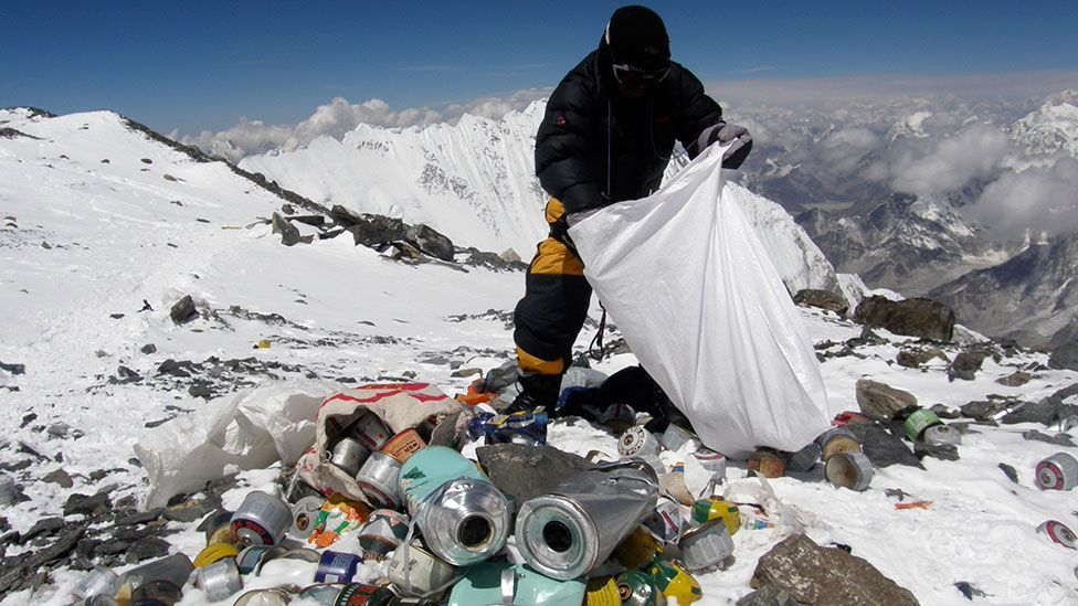 Collecting rubbish left by climbers on Everest in the Himalayas (Getty Images)