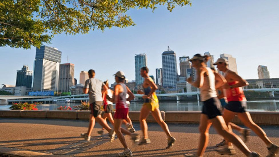 Runners along the waterfront take advantage of warm weather. (Andrew Watson/Getty Images)