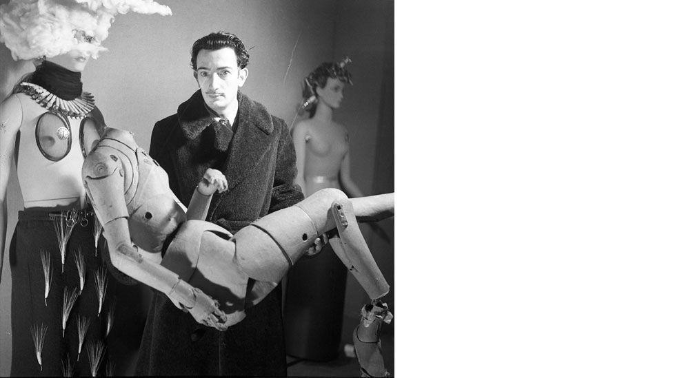 Photographer Denise Bellon captured Salvador Dalí holding an artist's lay figure in Paris, 1938 (Salvador Dalí, Fundació Gala-Salvador Dalí, DACS, 2014)