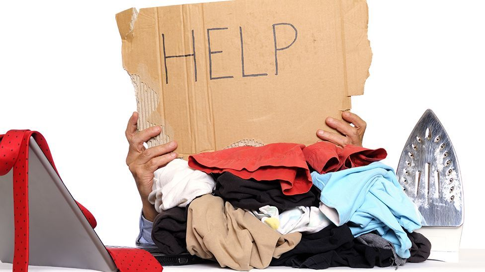 Do job responsibilities go as far as doing the laundry for your boss? (Lisa Blue/Getty)