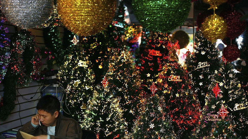 A vendor on a Christmas tree stall in Yiwu's wholesale market in 2006 (Getty Images)