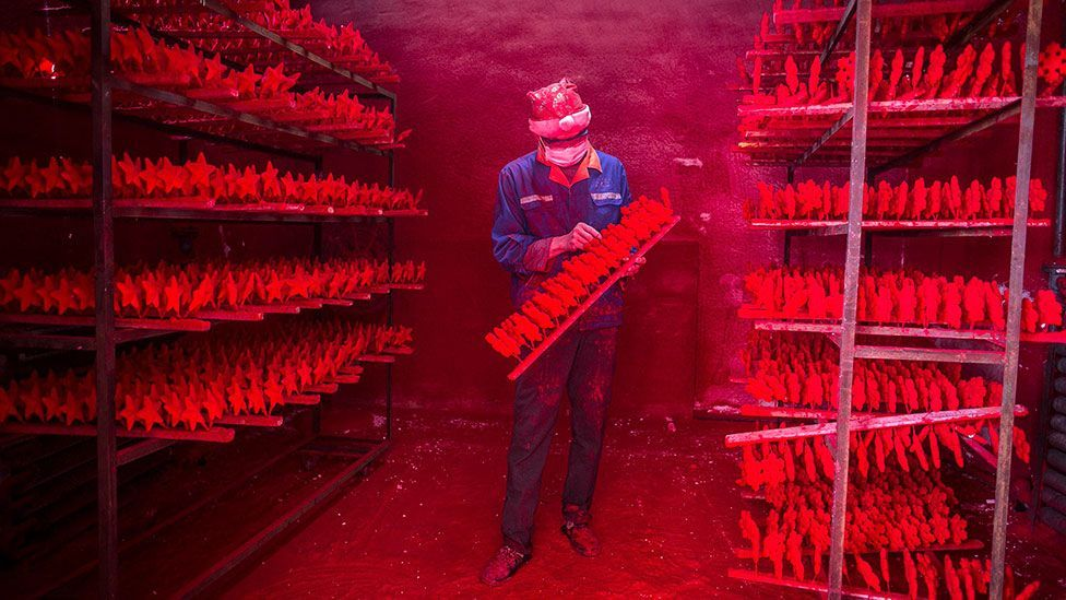 Yet another factory in Yiwu crafting decorations and more, ready to be sold at a humungous wholesale market. (Reuters)