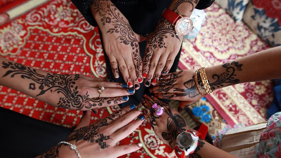 Yemeni girls show their hands decorated with traditional henna designs as they celebrate the end of Ramadan (Getty Images)