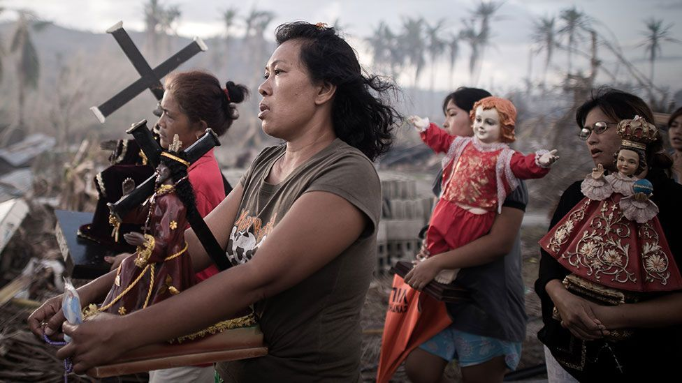 In the Philippines, survivors of Super Typhoon Haiyan march during a religious procession (Getty Images)