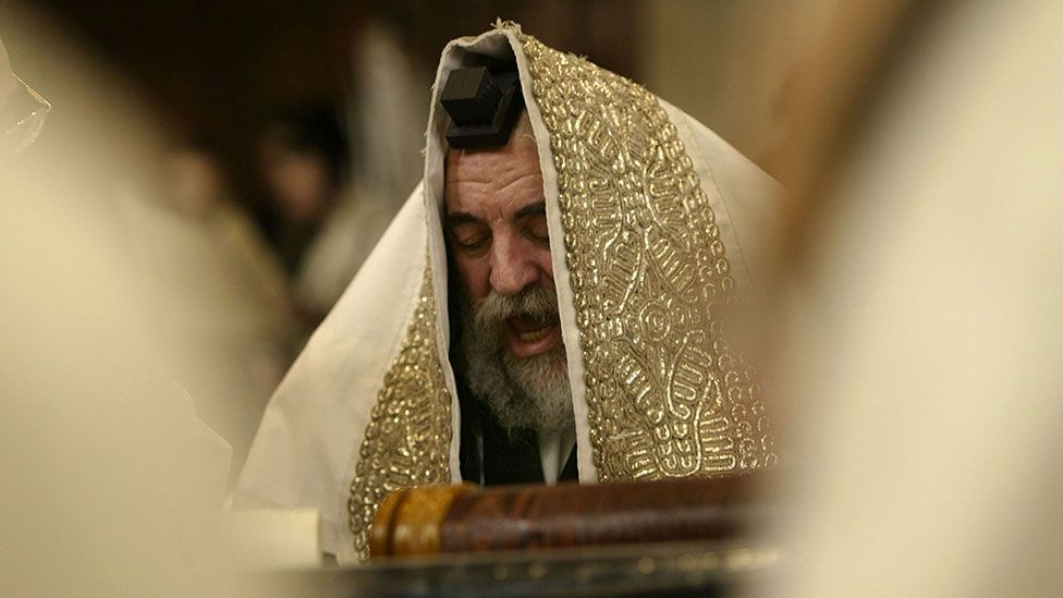 A rabbi reads during Purim festivities (Getty Images)