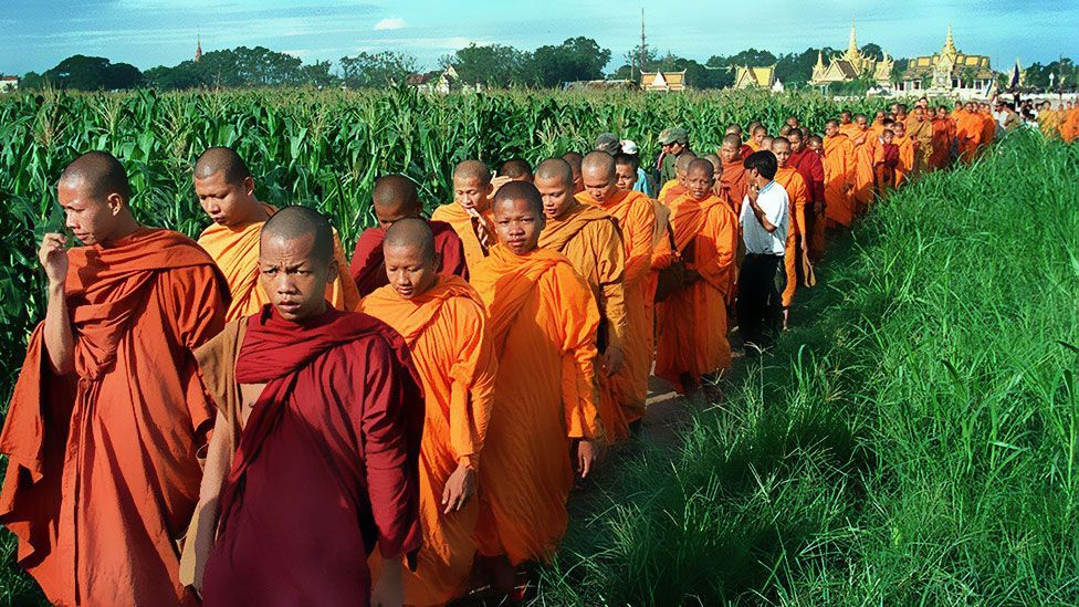 Buddhist monks file towards a ceremony at Sampov Treileak pagoda in Cambodia (Getty Images)