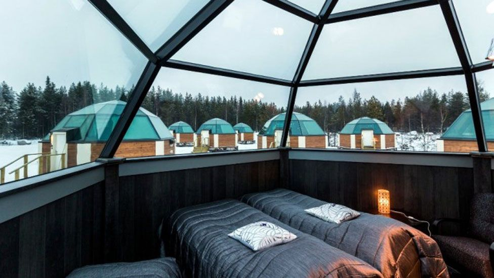 Glass igloos in Lapland, Finland, offer one way to view Northern Lights. (Arctic SnowHotel & Glass Igloos)