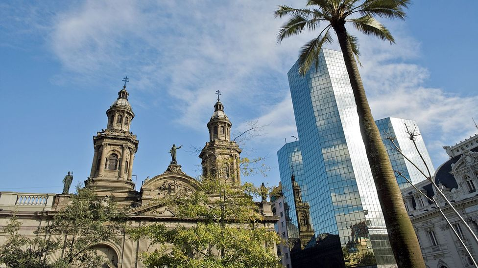 Santiago's historic buildings coexist with evidence of its rapid economic growth. (Thinkstock)