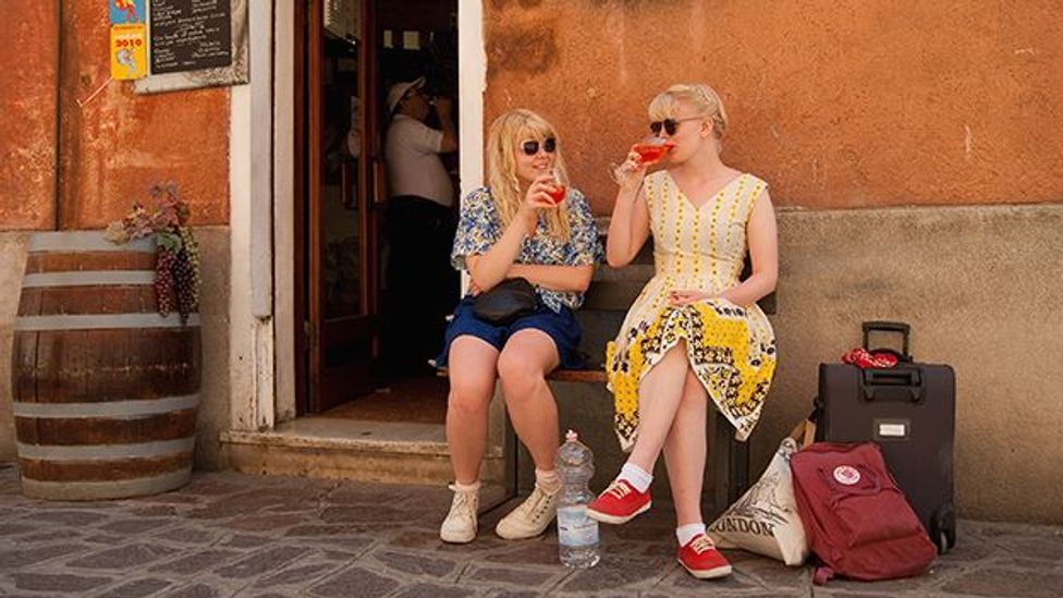 Two tourists enjoy a Spritz - a powerful mixture of white wine, Campari and soda water - in front of a traditional Venetian bacaro. (Getty)