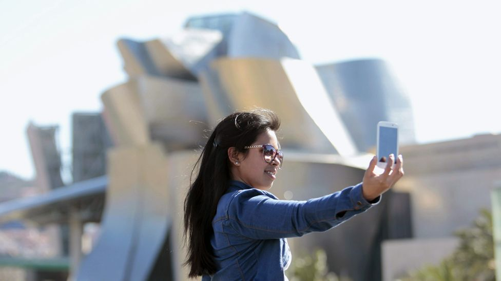 It's become popular for visitors to take photos of themselves in all different parts of a museum, including in the lobby, in the bathrooms and even outside (Corbis)