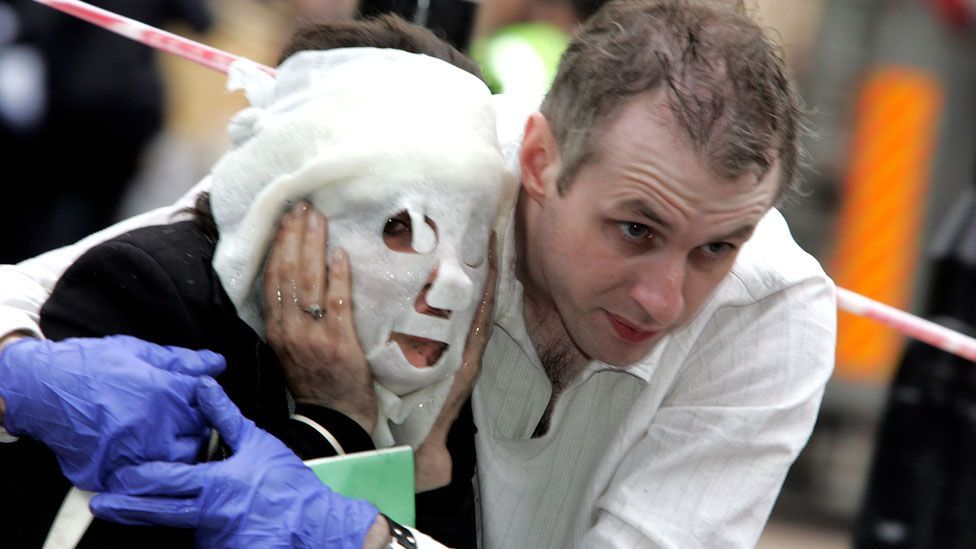 Paul Dadge helping injured passenger Davinia Turrell after the London bombings of 2005 - one of the defining images of the attack (Gareth Cattermole/Getty Images)