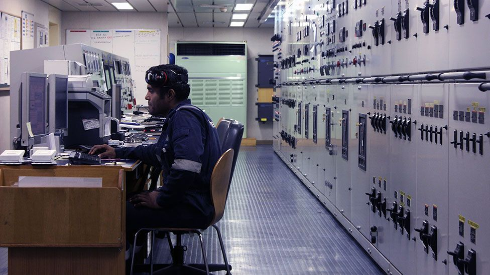 An engineer aboard the Maersk Seletar monitors engine temperature from the control room (Liam Young/Unknown Fields)