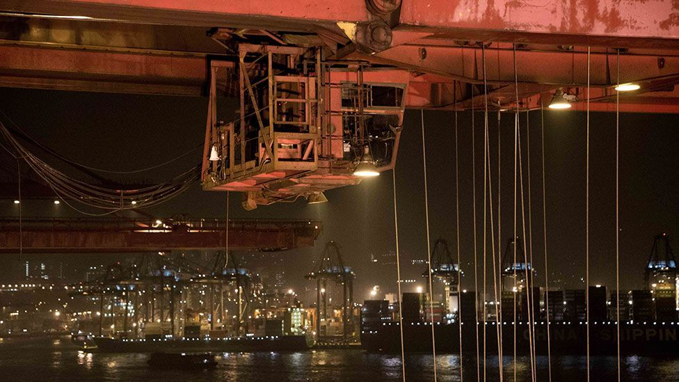 Giant cranes load ships in Hong Kong (Kate Davies/Unknown Fields)