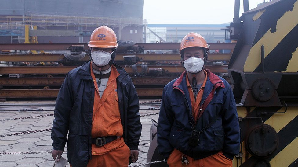 Two shipyard workers take a break from the fumes (Liam Young/Unknown Fields)