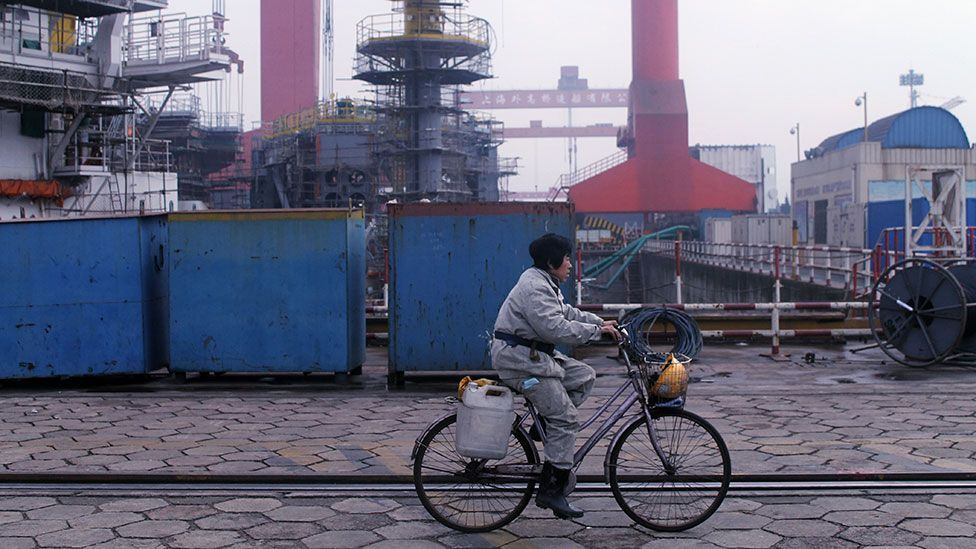 Shipyard workers use bicycles to cover the vast territory of the construction site (Liam Young/Unknown Fields)