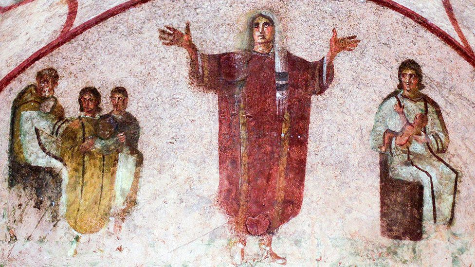 A fresco that shows a female figure with her hands outstretched has been put forward as evidence of women priests in the early Church (Max Rossi/Reuters/Corbis)