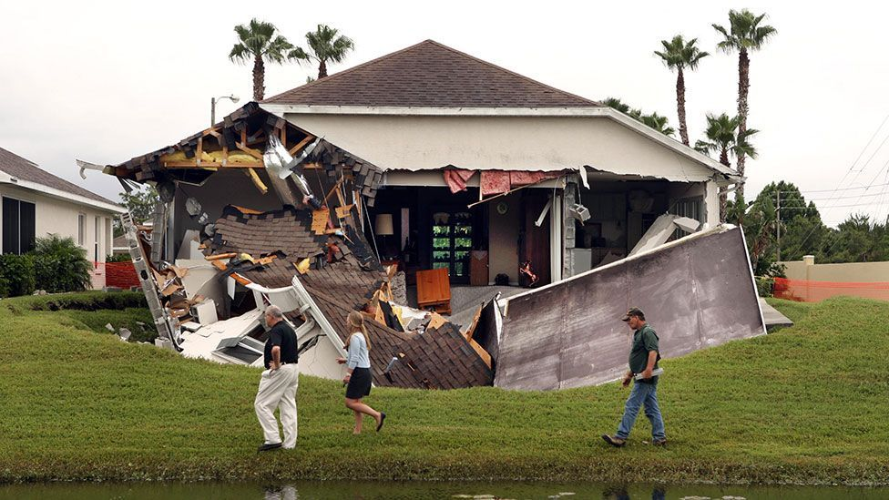 A home in Hudson, Florida destroyed by a 40 foot-wide (12m) sinkhole (Alamy)