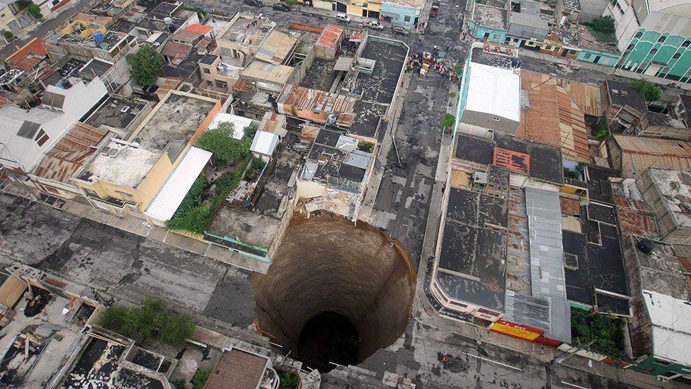 A giant sinkhole in Guatemala City (AP/Guatemala's Presidency, Luis Echeverria)
