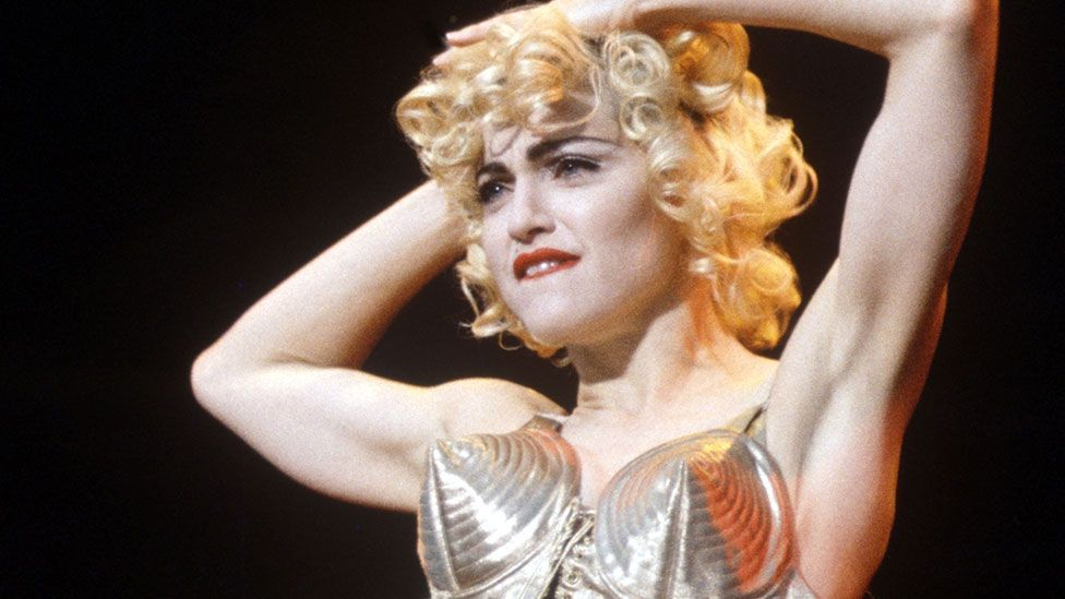 Madonna in her cone bra is one of the most unforgateeable images of the 1990s (Rex Features)