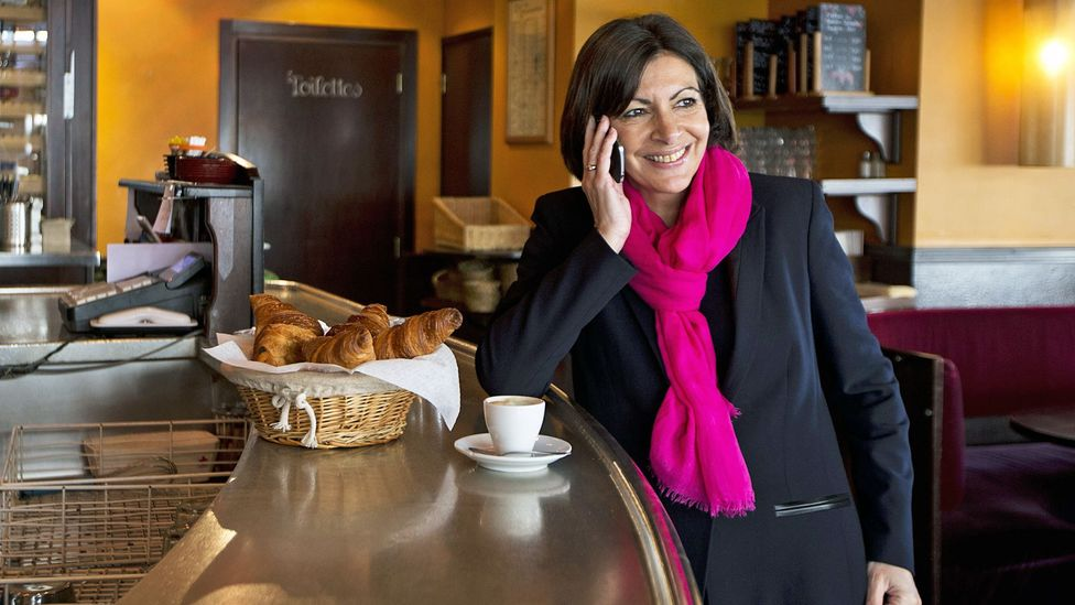 Mayor of Paris, Anne Hidalgo, often wears chic scarves. (Credit: Joel Saget/AFP/Getty Images)