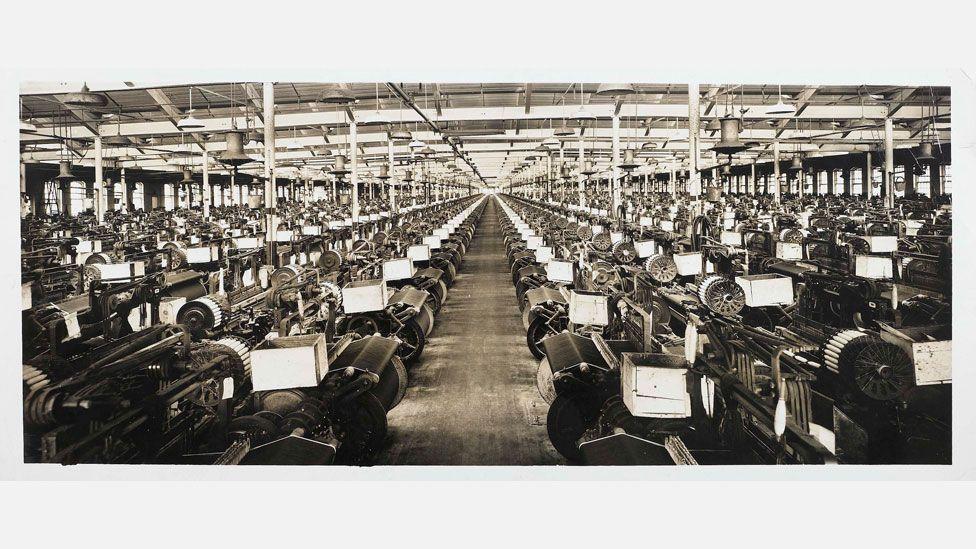 The weave room at Cone Denim's White Oak mill circa 1909 (Credit: Courtesy of Cone Denim, LLC)