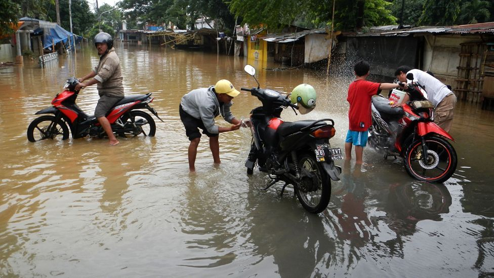 Jakarta's streetsare flooded when the monsoon rains hit, causing untold chaos (Credit: AFP/Getty Images)