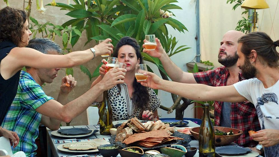 Diners enjoy a home-cooked meal in Tel Aviv hosted by Yael Sela and Keren Ella Gefen. (Credit: EatWith)