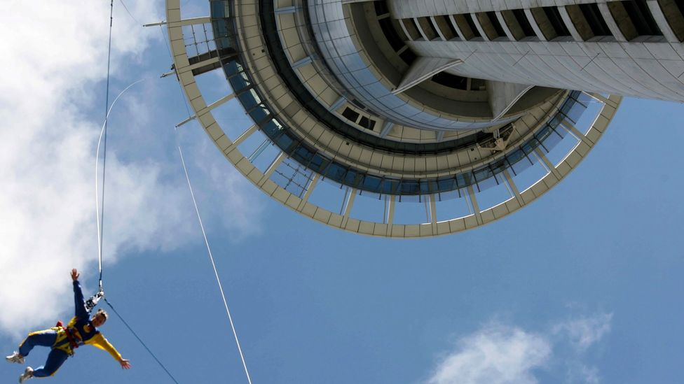 Bungee jumpers leap from the Sky Tower, the tallest man-made structure in the Southern Hemisphere. (Credit: Thinkstock)
