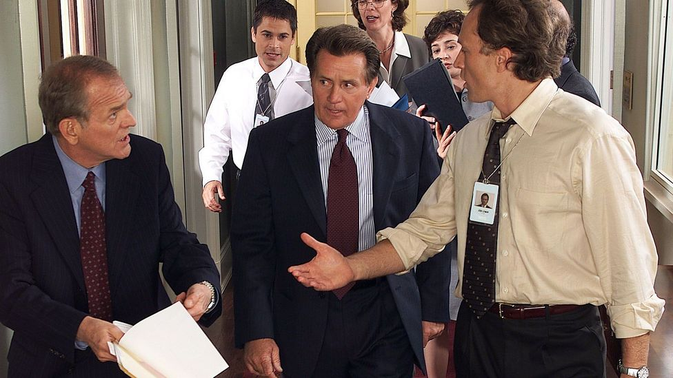 Problem solving with just a few steps? The art of the walk and talk, on display during a scene of the US show West Wing. (Credit: Warner Bros Television)