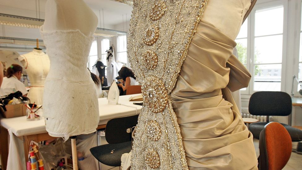 Chanel artisans hand-make couture from the finest materials. (Credit: Francois Durand/Getty Images)