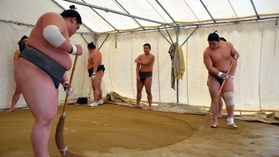Preparing the dohyo before training (Credit: Matthew Bremner)