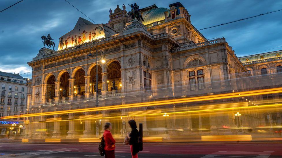 A tram passes in front of the Wiener Staatsoper, Vienna's State Opera (Credit: Joe Klamar/AFP/Getty Images)