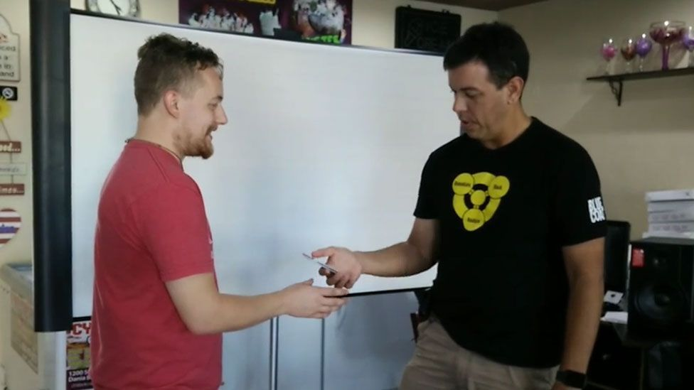 Seth Wahle (left) tests his implant with Rod Soto