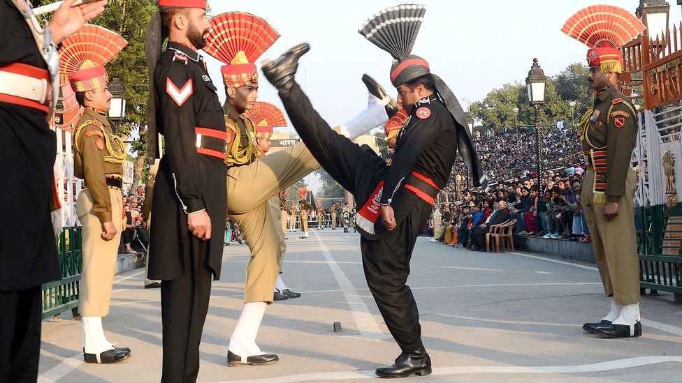 Indian and Pakistani guards face off in a border ceremony (Credit: Getty)