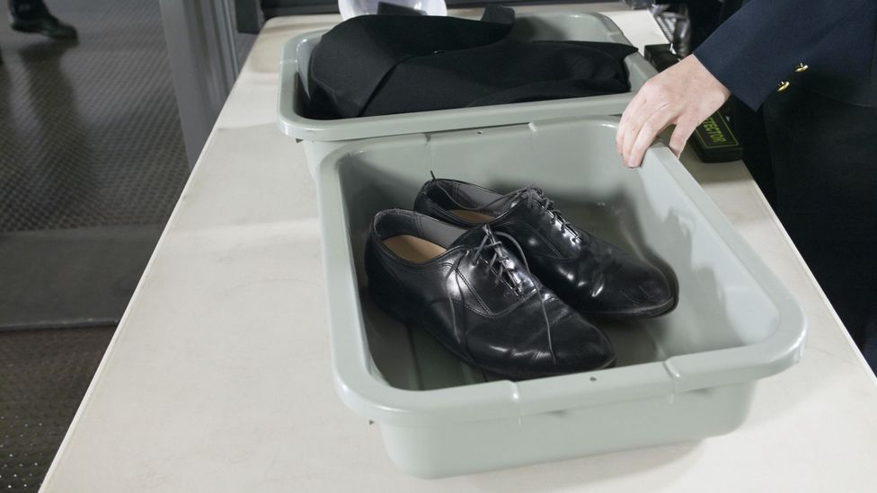 Some airports require all pairs of shoes to go through scanners (Credit: Getty Images)