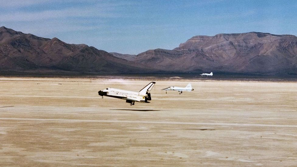 Two T-28 Talons escort the Space Shuttle Columbia onto the tarmac at White Sands in 1982 (Credit: Nasa)