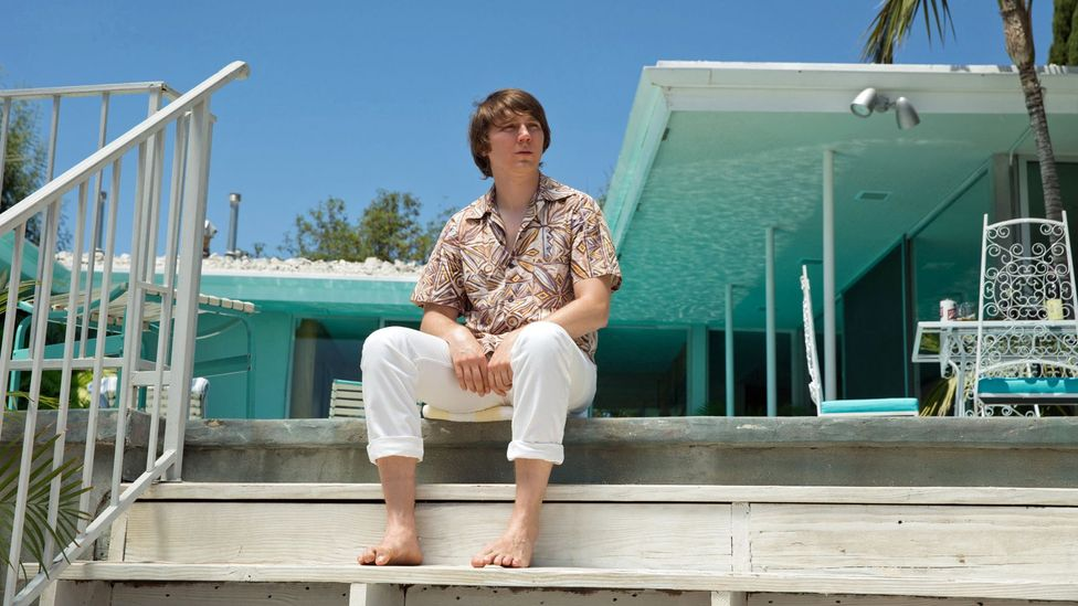 Paul Dano plays Wilson during The Beach Boys 1960s heyday in the new film Love and Mercy – with John Cusack portraying him as an older man (Credit: Lionsgate)