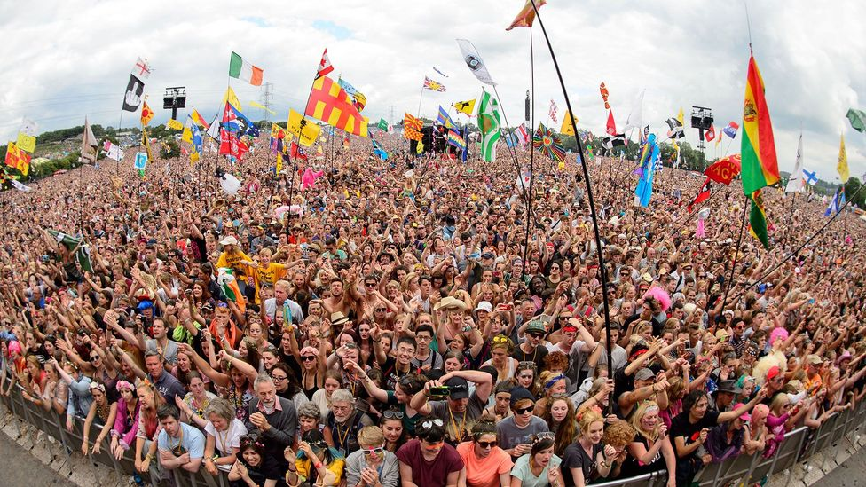 Would you recognise any of these faces again? Fans enjoy the music at the Glastonbury Festival (Credit: Leon Neal/AFP/Getty Images)