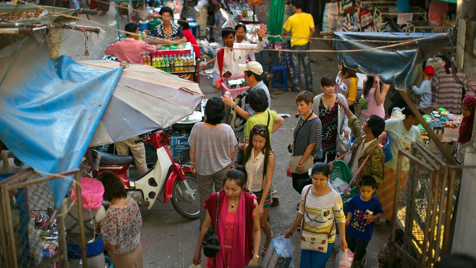 Shoppers in the Burmese border town of Tachileik (Credit: Paula Bronstein/Getty Images)