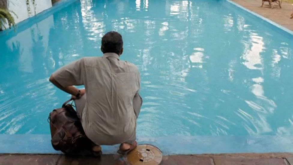 The Pool (2007) - one man's quest to swim in the luxurious pool of a middle-class villa (Credit: Vitagraph Films)