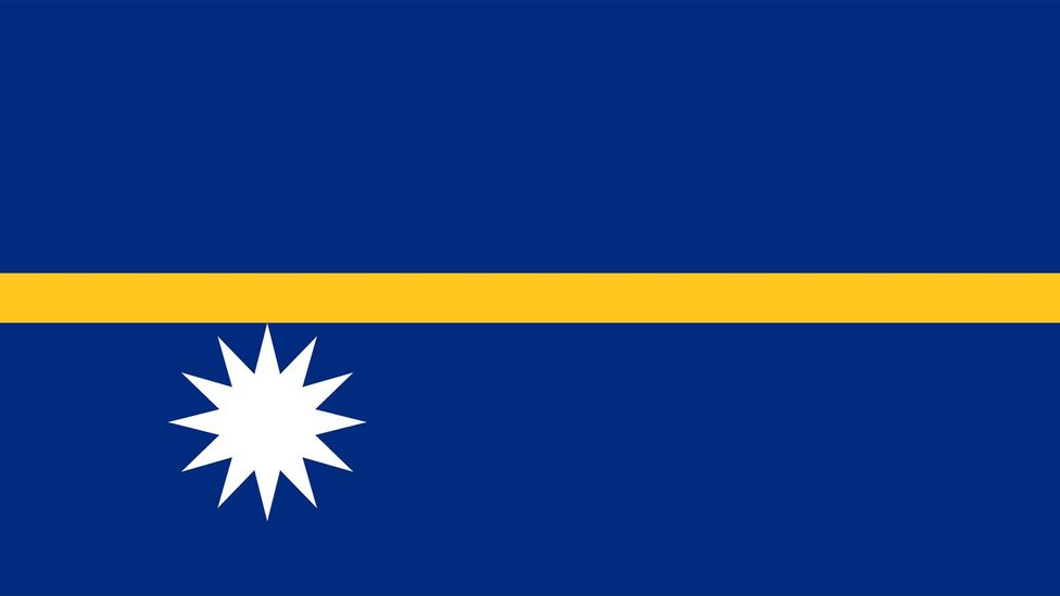 A yellow line across the centre of Nauru's flag marks the equator, and a large 13-pointed star represents the tiny Pacific nation's historic clans (Credit: Government of Nauru)