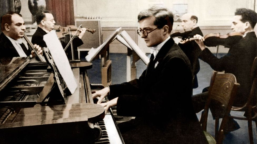 Shostakovich was also an accomplished pianist. In this photograph from 1940, he performs one of his own piano quintets with the Glazunov Quartet (Credit: Corbis)