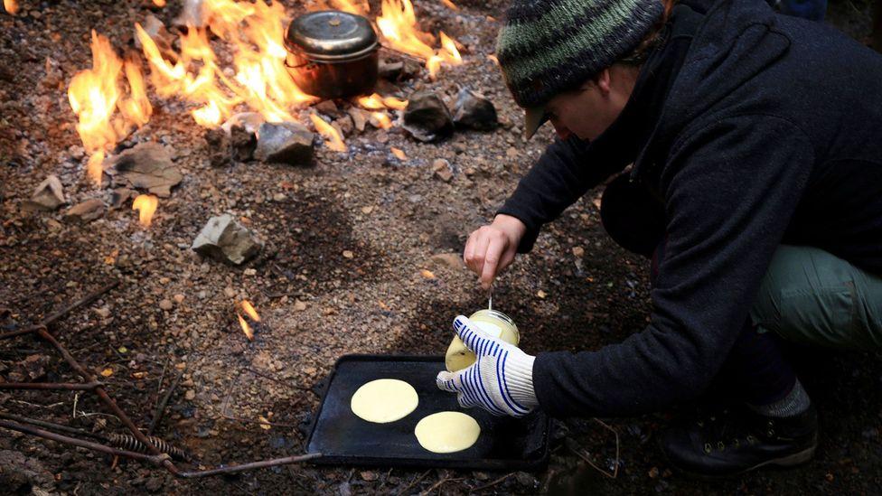 Preparing pancakes (Credit: Naomi Arnold)