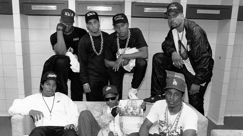 DJ Yella, Dr Dre, The DOC, Ice Cube, Eazy-E and MC Ren pose with Laylaw during their Straight Outta Compton tour (Credit: Raymond Boyd/Michael Ochs Archives/Getty Images)