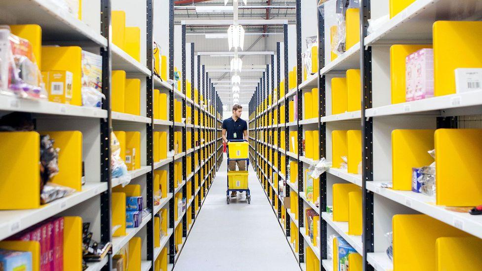 A worker collects items at Amazon's Hemel Hempstead warehouse (Credit: Amazon)