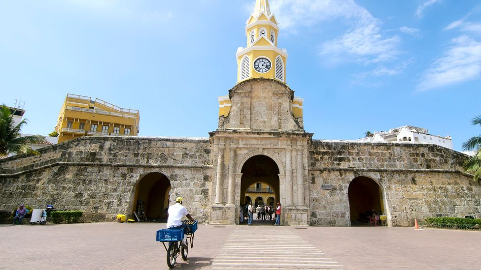 Bicycling through the Clock Tower in the walled city of Cartagena (Credit: Antonio Salinas L/Getty)