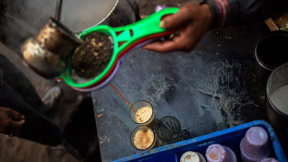 Pouring a cup of calming masala chai tea on India's chaotic streets (Credit: Rebecca Conway/Getty)