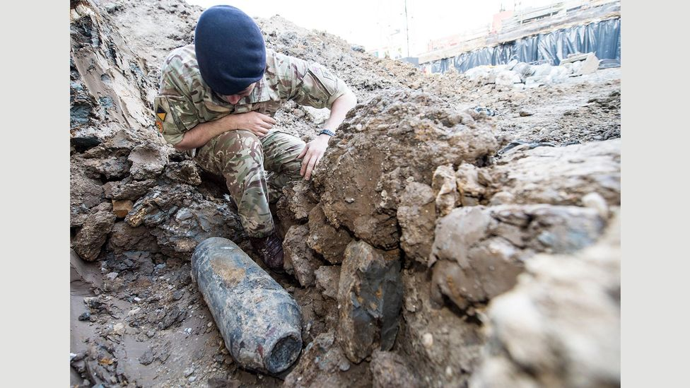 A soldier examines the Wembley bomb, one of many types of World War II ordnance that can be hazardous if mishandled (Credit: Ministry of Defence)